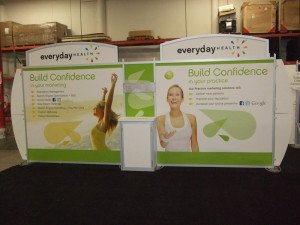 custom sacagawea portable hybrid trade show display with larger headers and locking storage